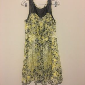 The limited yellow and gray floral pleated dress